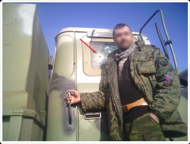 Separatist från brigaden Prizrak vid en KrAZ