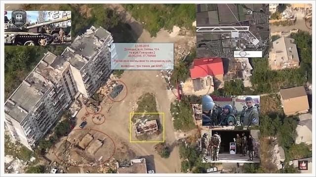 Sönderskjutet flervåningshus och ryska militärfordon i Donetsk