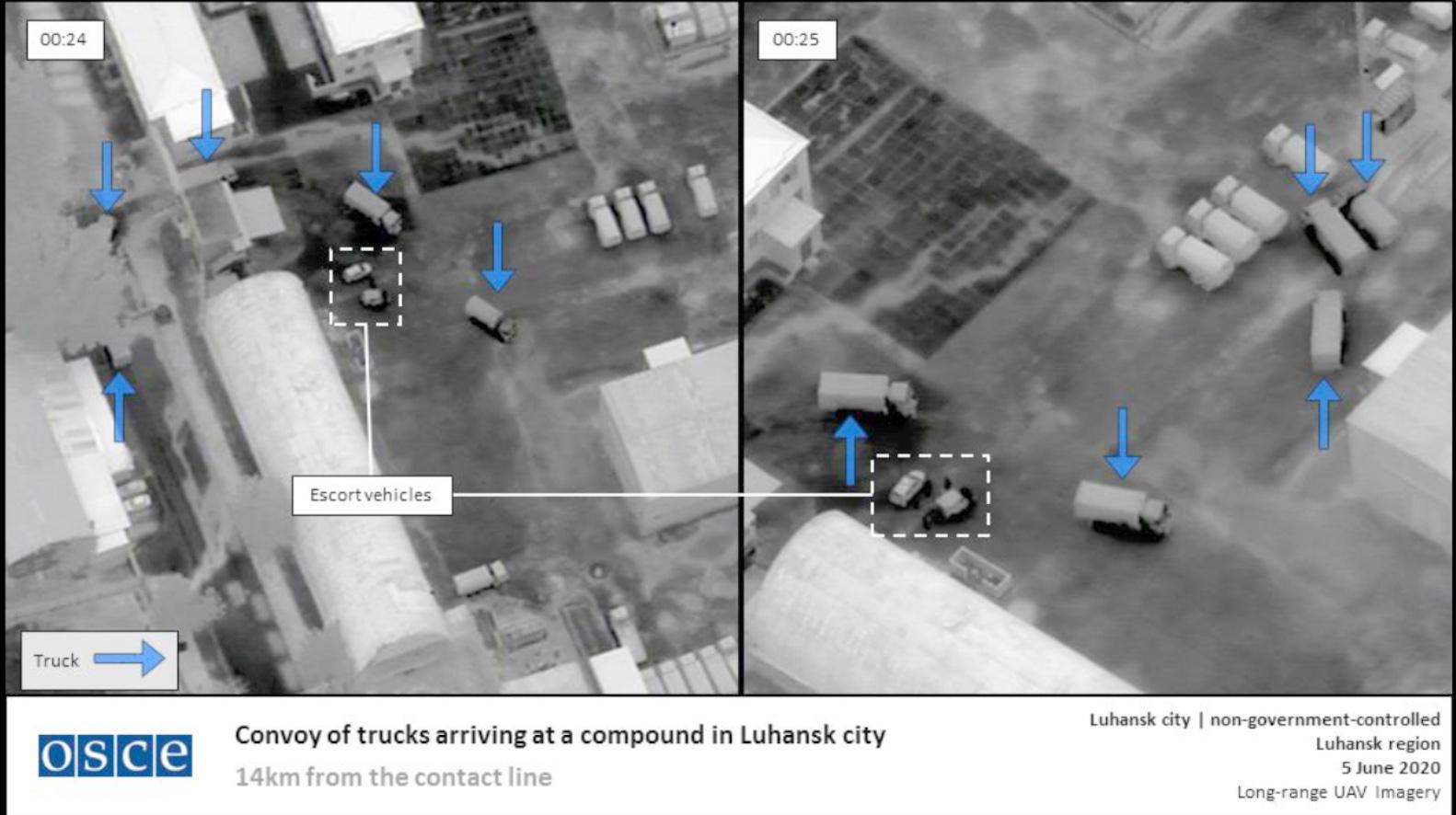 En rysk lastbilskonvoj med krigsutrustning i Luhansk, Ukraina