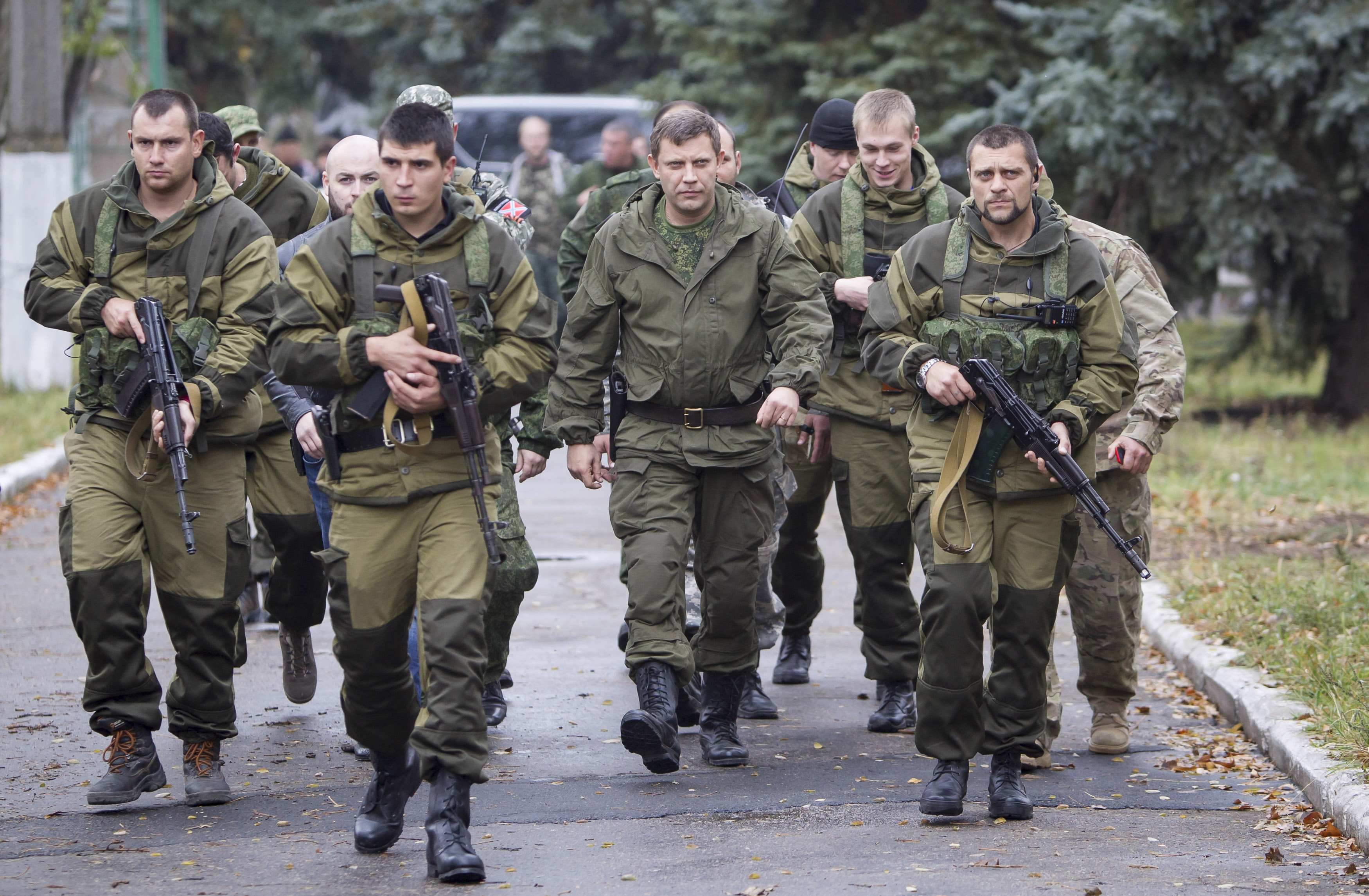 Prime Minister of the self-proclaimed Donetsk People's Republic Alexander Zakharchenko walks to meet local residents during his election campaign tour to the southern coastal town of Novoazovsk