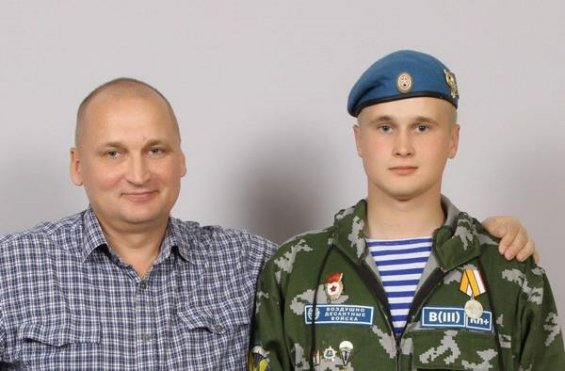 Nikolay Kozlov with his father. Medal For the Return of Crimea is on Nikolay's chest