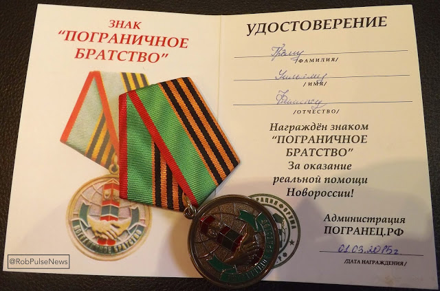 "Graham Phillips' actual award: a medal and certificate dated March 1st - a ""Distinction"" for ""support of Novorossiya"""