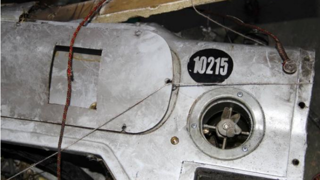 Part of the glider of an 'Orlan-10' drone, ID 10215, shot down on August 1, 2014