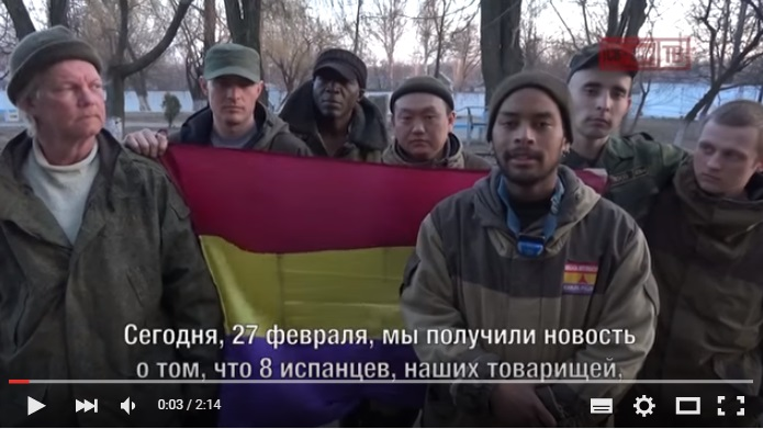 A screenshot from the video where the French citizens, militants of the Russian international 'Essence of Time', protest against arrest of their comrades